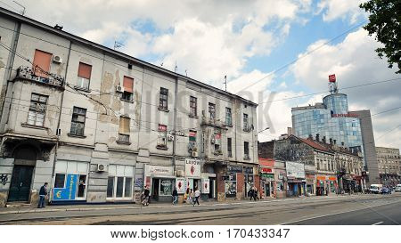 BELGRADE, SERBIA, JULY 3, 2014: Old street with buildings from the Yugoslavian era near the train station with tram rails, Belgrade, Serbia.