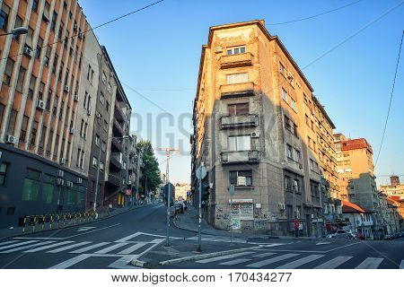 BELGRADE, SERBIA, JULY 3, 2014: Detail from old apartments from Yugoslavian era on the intersection of roads downtown Belgrade, Serbia.