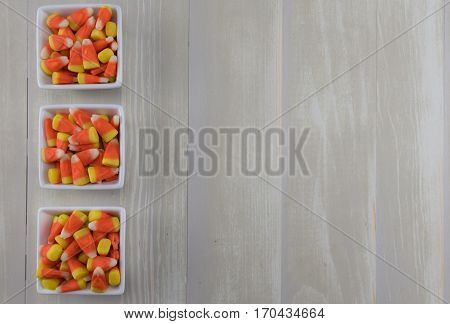Three Square Bowls of Candy Corn with copy space to right