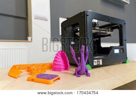 3D Printer And Printed Samples On The Table