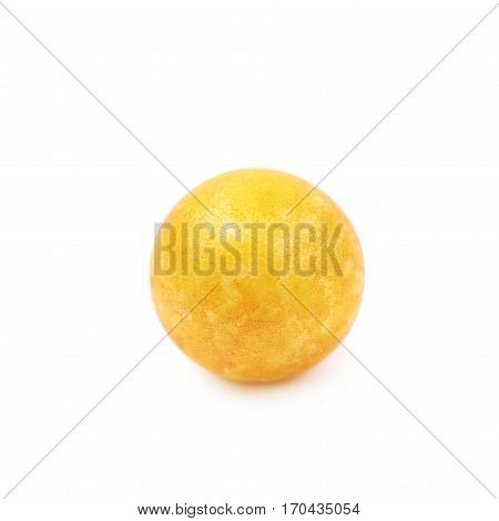 Single yellow colored foam ball or a corn cereal candy isolated over the white background