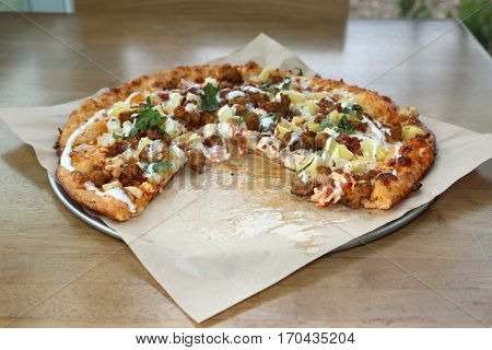 Pizza. Buffalo Chicken Pizza with Chicken Sausage and Pineapple.