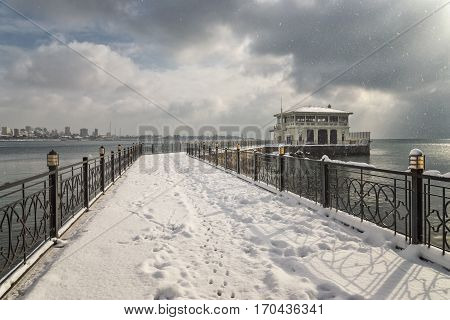ISTANBUL, TURKEY, JANUARY 8, 2017: Historic Moda Pier entrance covered with snow, famous landmark at Kadikoy, Istanbul, Turkey.