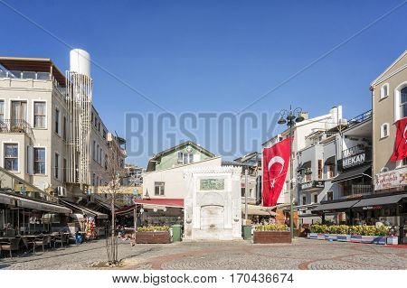 ISTANBUL, TURKEY, FEBRUARY 1, 2017: Historic drinking fountain at the center of town square from Ortakoy district of Besiktas, Istanbul, Turkey.