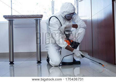 Man doing pest control at home