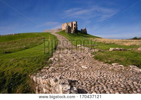Duffus Castle, Elgin, Moray, Scotland is a ruined stone built motte and bailey fortress first constructed in the 12th century and finally abandoned in 1705.