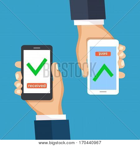 Online money transfer concept with two male hands holding smart phones with blank white screenscheck mark on blue background. Online payment internet banking pay with your cellphone.