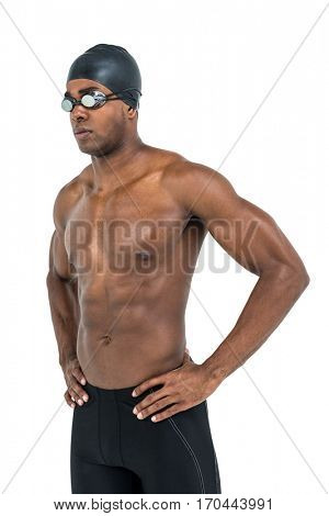 Swimmer standing with hand on hip on white background