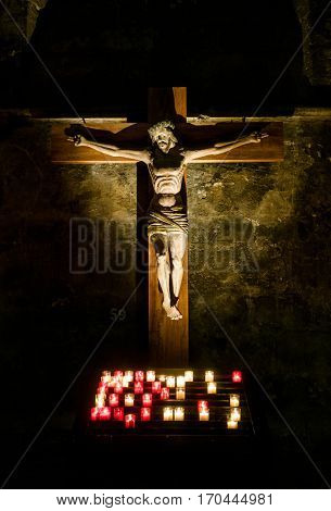 Jesus Christ on the cross lit by candles, Chartres Cathedral in France