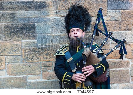 Bagpiper Playing Music In Edinburgh Castle
