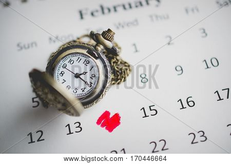 Marking on Date of Fourteen with Vintage Pocket Watch on the Calendar Image for Valentine Concept used for food ad or website promote.