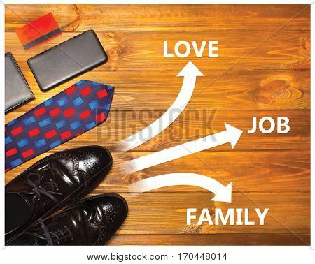 Future concept with business man shoes and road markings. Conceptual collage on wooden background