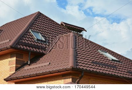 New roofing construction with attic skylights rain gutter system roof windows and roof protection from snow board snow guard exterior.