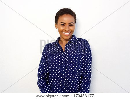 Attractive Young Black Woman Smiling Against Isolated White Background
