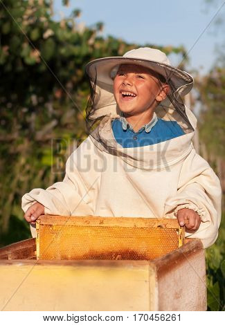Beekeeper a young boy who works in the apiary. Beekeeping