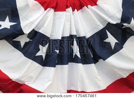 A patriotic bunting of red, white, and blue with stars and stripes is on display in the United States of America.