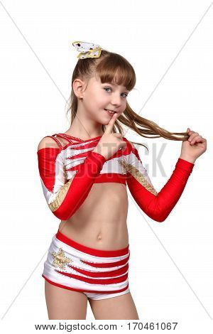 Young cheerleading girl with quiet gesture, close up.
