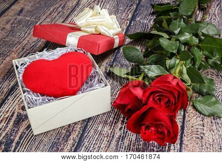 Fervent heart and red roses as a gift for Valentine's Day