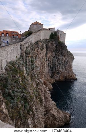 DUBROVNIK, CROATIA - NOVEMBER 30: Defense walls of the old town of Dubrovnik, a well-preserved medieval fortress and a popular tourist destination, Croatia on November 30, 2015.