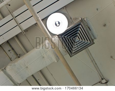 Mask of air duct and lamp on ceiling