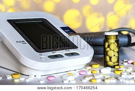 White medical device for measuring arterial pressure on the table