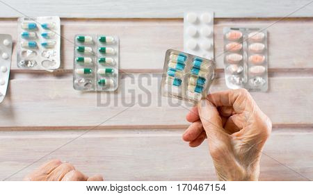 Senior Hands Picking Her Today Pills
