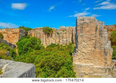 Old abandoned stone quarry Lithica Pedreres des Hostal, Menorca island, Spain. Popular place to take a walk.