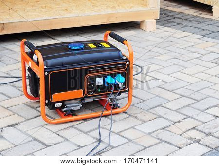 Gasoline Portable Generator on the House Construction Site. Close up on Mobile Backup Generator. Standby Generator - Outdoor Power Equipment.