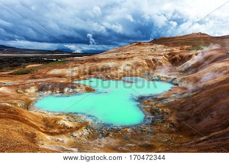 Acid hot lake in the geothermal valley Leirhnjukur, near Krafla volcano, Iceland, Europe.