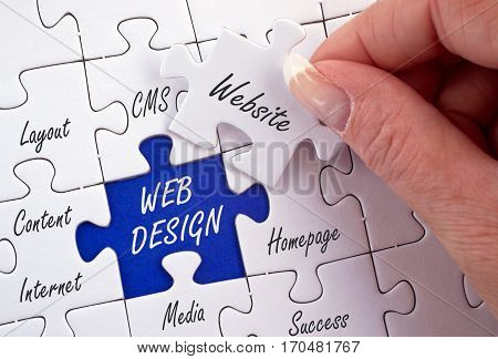 Web Design - female hand with business puzzle