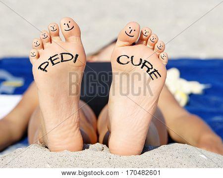 Pedicure - feet of woman with smileys and text
