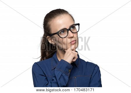 Portrait of puzzled woman in glasses on white background
