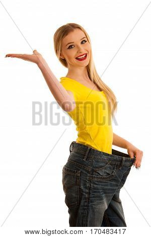 Woman Gesturing Success As She Lost Weight Wearing Too Big Trousers Isolated Over White