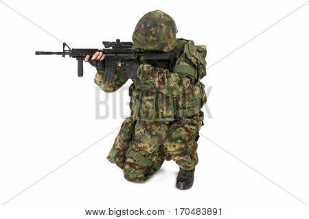 Armed soldier isolated on the white background