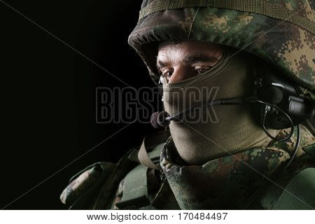 Soldier closeup picture on the black background