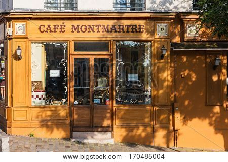 Paris France - July 06 2016: The charming Cafe Montmartre on Montmartre hill. Montmartre with traditional french cafes and art galleries is one of the most visited landmarks in Paris.