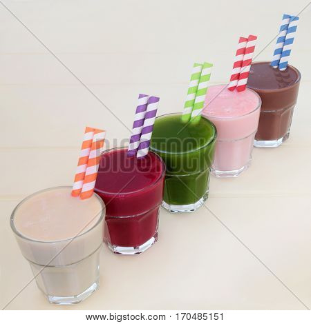 Health food drinks of maca root, pomegranate fruit, wheat grass, acai berry