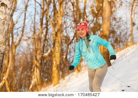 Lady Exercising In Winter
