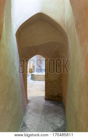 Aged narrow dark vaulted passage Medieval Cairo Egypt
