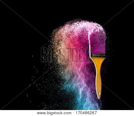 paint brushes with abstract powder color explosion isolated on black background full color concept.