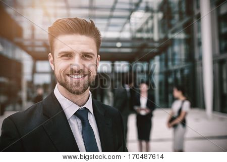 Portrait of happy businessman in office premises