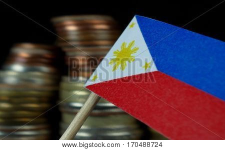 Philippines Flag Waving With Stack Of Money Coins Macro