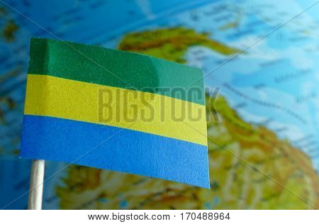 Gabon Flag With A Globe Map As A Background Macro