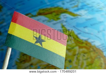 Ghana Flag With A Globe Map As A Background Macro
