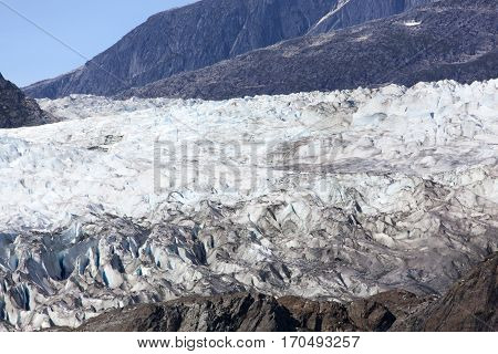 The close view of a glacier in Glacier Bay national park (Alaska).