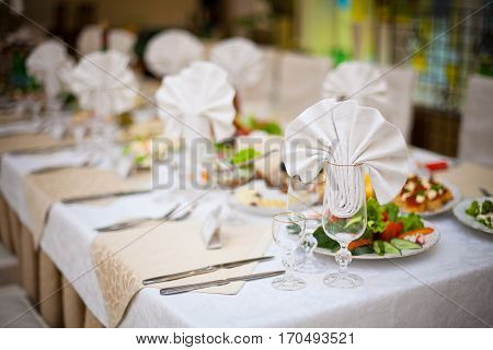 Festive table setting. Laying of a holiday table. Food background.