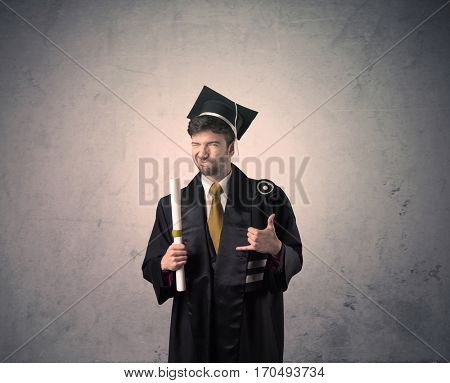 Portrait of a happy young graduate student on grungy background