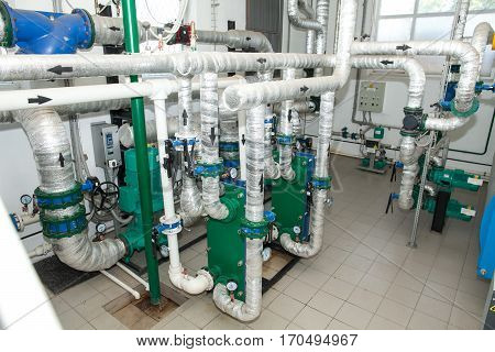 Pipes in a boiler room. Isolation of pipes. Water heating. Power supply. Water supply. Modern boiler room equipment. High power boiler burner. Boiler room. Water heating. Power supply. Water supply.