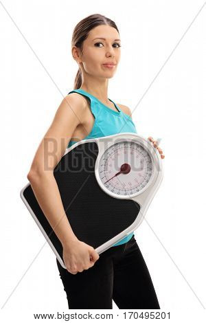 Young woman with a weight scale isolated on white background