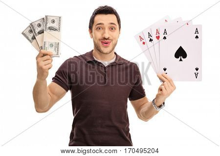 Happy young man holding bundles of money and four aces isolated on white background